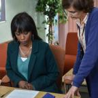 Sutton Guardian: EastEnders snaps show Denise hovering over adoption forms