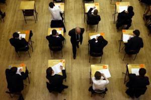 MPs warn of falling school standards amid savings drive 'delusion'