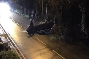 Emergency services were called Ewell Road, at the junction of Robert's Close, after the car overturned shortly at about 12.25am earlier today