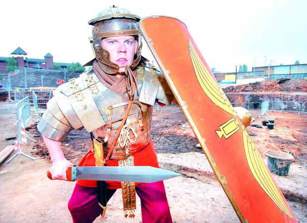 Sutton Guardian: In action: Paul Harding from Living History dressed as a Roman soldier who will be on hand throughout the open day. 38014202.