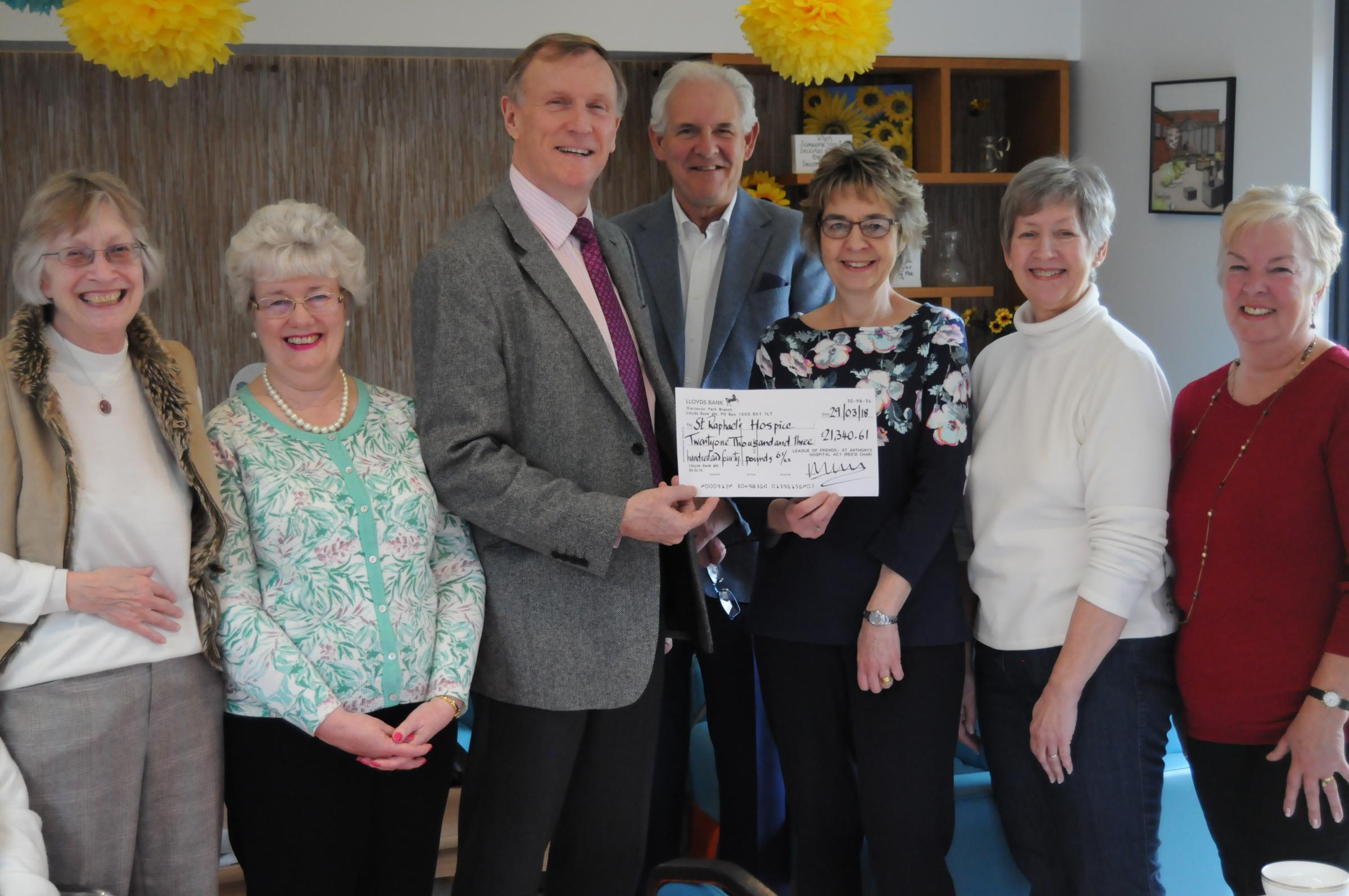 St Raphael's Hospice chief executive (third from left) with chair of trustees Sue Poulter (third from right) with members from left to right - Raye-Sheerman Chase, Diane Robinson, Paul Sonnex, Judith Capper-Allen, and Lyn Lovelock